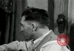 Image of Two men and a boy listening to a radio United States USA, 1935, second 4 stock footage video 65675068712