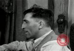 Image of Two men and a boy listening to a radio United States USA, 1935, second 5 stock footage video 65675068712