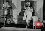 Image of designer fashions by Dior and Bohan Paris France, 1955, second 8 stock footage video 65675068828