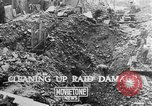 Image of clean up of bombing raid damage United Kingdom, 1940, second 1 stock footage video 65675068886
