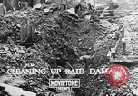 Image of clean up of bombing raid damage United Kingdom, 1940, second 2 stock footage video 65675068886