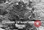 Image of clean up of bombing raid damage United Kingdom, 1940, second 3 stock footage video 65675068886