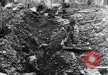 Image of clean up of bombing raid damage United Kingdom, 1940, second 4 stock footage video 65675068886