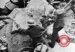 Image of clean up of bombing raid damage United Kingdom, 1940, second 11 stock footage video 65675068886