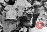 Image of clean up of bombing raid damage United Kingdom, 1940, second 12 stock footage video 65675068886
