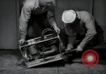 Image of gasoline handy billy United States USA, 1950, second 2 stock footage video 65675069049