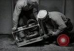 Image of gasoline handy billy United States USA, 1950, second 5 stock footage video 65675069049