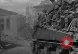 Image of U.S. forces pass through wrecked town near end of World War II Gemunden Germany, 1945, second 6 stock footage video 65675069289