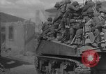 Image of U.S. forces pass through wrecked town near end of World War II Gemunden Germany, 1945, second 7 stock footage video 65675069289