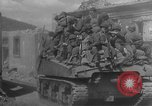 Image of U.S. forces pass through wrecked town near end of World War II Gemunden Germany, 1945, second 9 stock footage video 65675069289