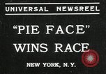 Image of pie eating contest New York United States USA, 1935, second 1 stock footage video 65675069441