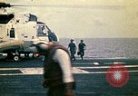 Image of VNAF Major Buang-Ly landing a Cessna O-1 on USS Midway South China Sea, 1975, second 11 stock footage video 65675069507