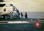Image of VNAF Major Buang-Ly landing a Cessna O-1 on USS Midway South China Sea, 1975, second 12 stock footage video 65675069507