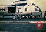 Image of VNAF Major Buang-Ly landing a Cessna O-1 on USS Midway South China Sea, 1975, second 15 stock footage video 65675069507