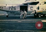 Image of VNAF Major Buang-Ly landing a Cessna O-1 on USS Midway South China Sea, 1975, second 16 stock footage video 65675069507