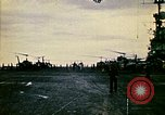 Image of Crew of USS Midway push helicopters overboard  South China Sea, 1975, second 1 stock footage video 65675069508
