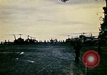 Image of Crew of USS Midway push helicopters overboard  South China Sea, 1975, second 4 stock footage video 65675069508