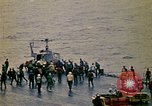 Image of Crew of USS Midway push helicopters overboard  South China Sea, 1975, second 5 stock footage video 65675069508