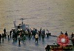 Image of Crew of USS Midway push helicopters overboard  South China Sea, 1975, second 6 stock footage video 65675069508
