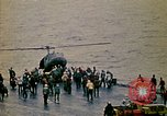 Image of Crew of USS Midway push helicopters overboard  South China Sea, 1975, second 7 stock footage video 65675069508