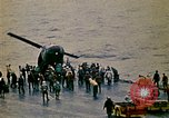 Image of Crew of USS Midway push helicopters overboard  South China Sea, 1975, second 8 stock footage video 65675069508