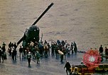 Image of Crew of USS Midway push helicopters overboard  South China Sea, 1975, second 9 stock footage video 65675069508