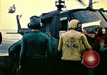 Image of Crew of USS Midway push helicopters overboard  South China Sea, 1975, second 12 stock footage video 65675069508
