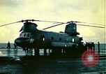 Image of VNAF helicopters on USS Midway during evacuation from Saigon South China Sea, 1975, second 1 stock footage video 65675069509