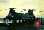 Image of VNAF helicopters on USS Midway during evacuation from Saigon South China Sea, 1975, second 2 stock footage video 65675069509