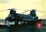 Image of VNAF helicopters on USS Midway during evacuation from Saigon South China Sea, 1975, second 3 stock footage video 65675069509