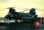 Image of VNAF helicopters on USS Midway during evacuation from Saigon South China Sea, 1975, second 4 stock footage video 65675069509