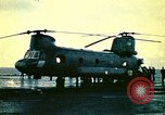 Image of VNAF helicopters on USS Midway during evacuation from Saigon South China Sea, 1975, second 5 stock footage video 65675069509