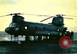 Image of VNAF helicopters on USS Midway during evacuation from Saigon South China Sea, 1975, second 6 stock footage video 65675069509