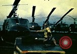 Image of VNAF helicopters on USS Midway during evacuation from Saigon South China Sea, 1975, second 11 stock footage video 65675069509