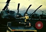 Image of VNAF helicopters on USS Midway during evacuation from Saigon South China Sea, 1975, second 12 stock footage video 65675069509
