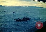 Image of Evacuees in small boats helped to board the USS Blue Ridge South China Sea, 1975, second 5 stock footage video 65675069510