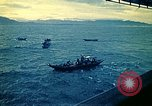 Image of Evacuees in small boats helped to board the USS Blue Ridge South China Sea, 1975, second 7 stock footage video 65675069510