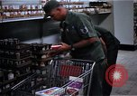 Image of Personnel buy food items Saigon Vietnam, 1965, second 6 stock footage video 65675069607