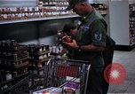 Image of Personnel buy food items Saigon Vietnam, 1965, second 7 stock footage video 65675069607