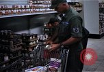 Image of Personnel buy food items Saigon Vietnam, 1965, second 9 stock footage video 65675069607