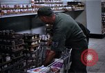 Image of Personnel buy food items Saigon Vietnam, 1965, second 10 stock footage video 65675069607