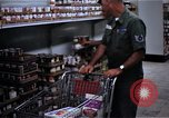 Image of Personnel buy food items Saigon Vietnam, 1965, second 11 stock footage video 65675069607