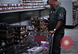 Image of Personnel buy food items Saigon Vietnam, 1965, second 12 stock footage video 65675069607