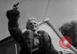 Image of raccoon coats United States USA, 1957, second 12 stock footage video 65675069673