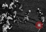 Image of American football match Iowa United States USA, 1956, second 5 stock footage video 65675069760
