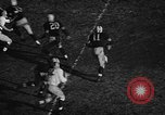 Image of American football match Iowa United States USA, 1956, second 6 stock footage video 65675069760