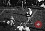 Image of American football match Iowa United States USA, 1956, second 9 stock footage video 65675069760