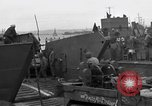 Image of Loading Allied landing craft  for D-Day invasion of France England, 1944, second 11 stock footage video 65675069838