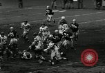 Image of football match New York United States USA, 1956, second 10 stock footage video 65675069885