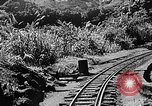 Image of Steam locomotive pushing a train backwards Taiwan, 1940, second 10 stock footage video 65675069924
